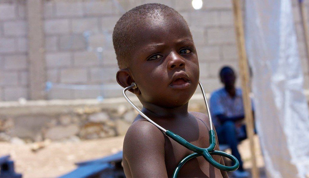 Child with stethoscope on mission trip