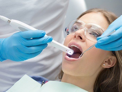 woman with intraoral camera in mouth
