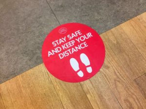 sticker on the floor as a reminder for social distancing in Skokie