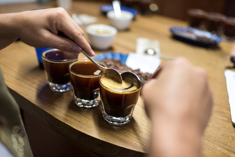 Three coffee cups in a row for tasting