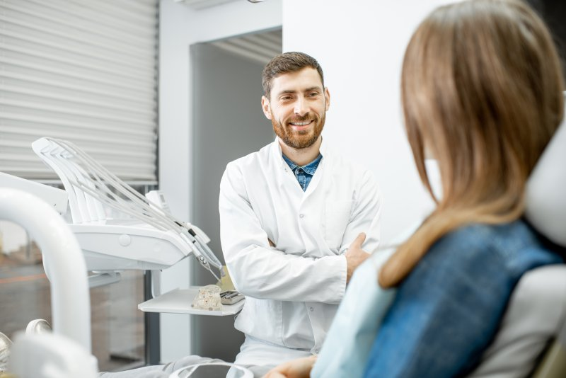 Dentist and patient talking during a dental implant consultation